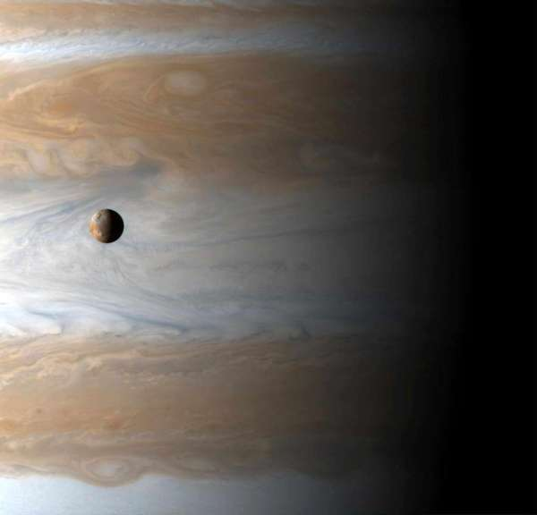 This image shows the Galilean satellite Io above the cloudtops of Jupiter. Astronomers say they are now searching for exomoons around exoplanets -- those beyond our solar system.