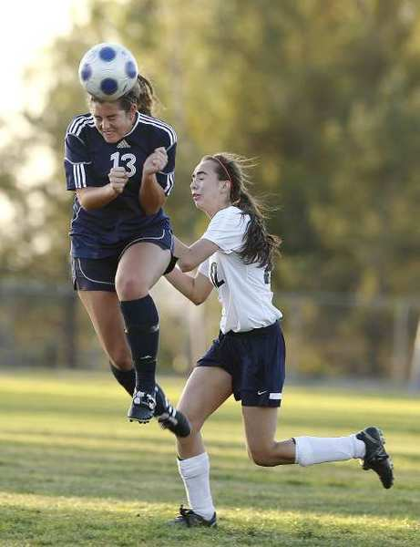 Corona del Mar High's Karsten Sigband, left, goes up for a header against Northwood's Maren Martinez during a Pacific Coast League game at Northwood High on Thursday.