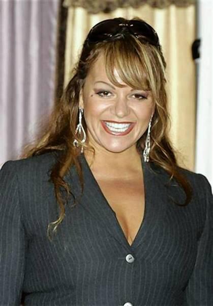 Relatives of singer Jenni Rivera's co-passengers sue over plane crash