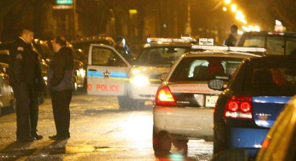 Chicago police work at the scene of a shooting at near 63rd Street and Honore Avenue, in Chicago.
