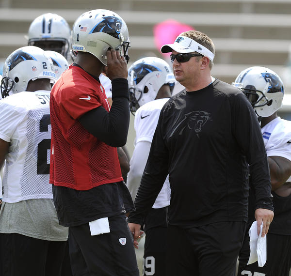 Panthers offensive coordinator Rob Chudzinski, who got the Browns' head coaching job, talks to Cam Newton.