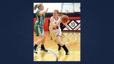 Meyersdale's Hayley Petenbrink drives past a Portage defender during a girls basketball game Thursday.