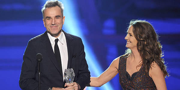 "Presenter Melissa Leo (R) looks on as actor Daniel Day-Lewis accepts the Best Actor Award for ""Lincoln."""