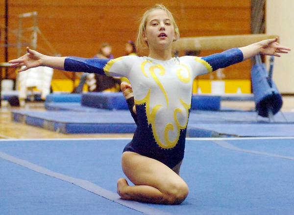 Aberdeen Central's Tessa Kimbler performs her floor routine at the Watertown Triangular on Thursday.