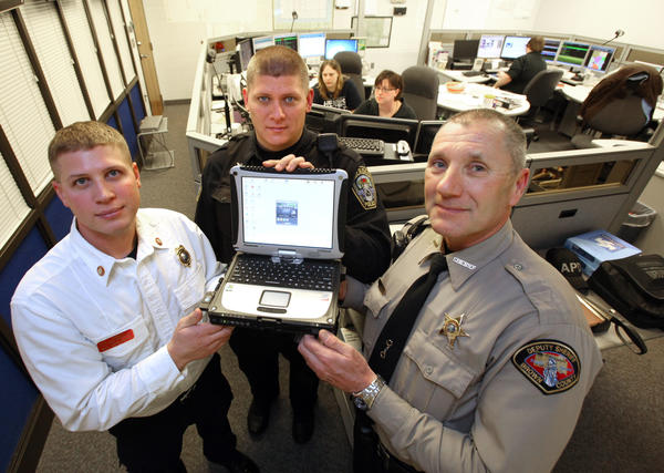 A new computer software will interconnect law and rescue personnel, the Brown County Jail and the Brown County Dispatch Center, including Max Stoltenburg, deputy fire marshal with Aberdeen Fire and Rescue, left, Michael Law, an officer with the Aberdeen Police Department, center, and Scott Kolb, a deputy with the Brown County Sheriff's Office.