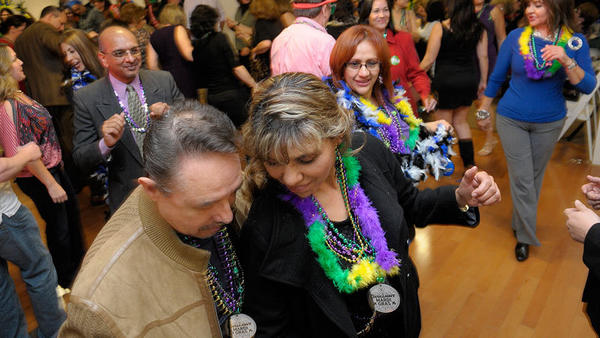 Attendees dance the night away during the Calexico Mardi Gras event last year at the Calexico Cultural Arts Center.