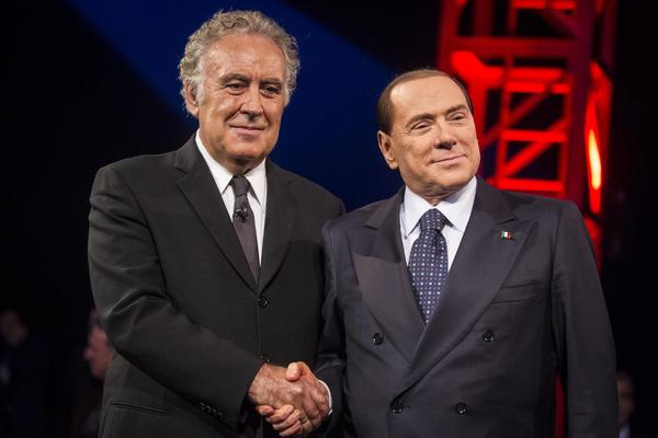 Italian journalist Michele Santoro, left, squared off against former Prime Minister Silvio Berlusconi, right, in a nationally televised interview Thursday night.