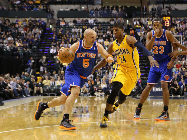 New York Knicks guard Jason Kidd (5) drives to the basket against Indiana Pacers forward Paul George (24.