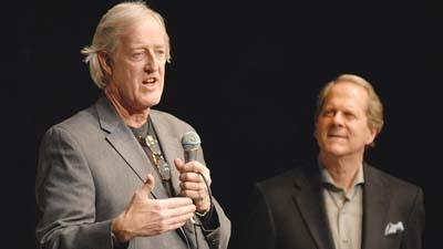 "Chip Duncan (left), writer/director of ""The Reagan Presidency,"" addresses the audience at a premiere event for the documentary Thursday at Crooked Tree Arts Center. David Crouse (right) is the documentary's executive producer."
