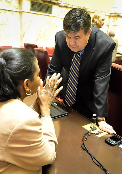 Maryland State Sen. Ron Young, D-Frederick/Washington, chats with Sen. Lisa A. Gladden, D-Baltimore City, on Jan. 9, the opening day of the Maryland General Assembly's 2013 session.