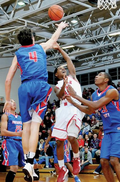Montgomery County standout Omar Prewitt blocks a shot by Clark¿s Malachi Israel during an earlier-season contest between the two rivals at Norton Gymnasium. The two teams will meet again Friday night in a boy-girl doubleheader at the MCHS¿Arena in Mount Sterling.