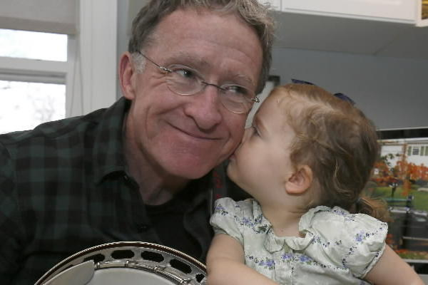 "Mike Leonard, who just retired after 32 years as a features correspondent on the ""Today"" show, gets a kiss from his granddaughter, June Trotter, 2, in his Winnetka home."