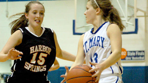 St. Mary senior Jada Bebble slows down the pace while being guarded by Harbor Springs junior Layne Compton.