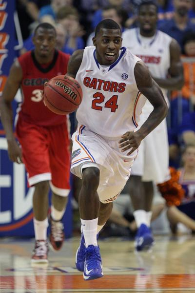Florida Gators guard/forward Casey Prather (24) dribbles the ball during the game against the Georgia Bulldogs at the Stephen C. O'Connell Center. Florida defeated Georgia 77-44.