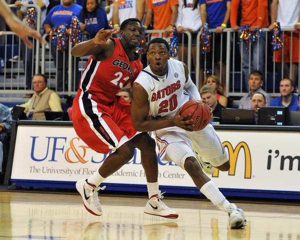 Guard Michael Frazier II #20 of the Florida Gators drives for a basket against the Georgia Bulldogs January 9, 2013 at Stephen C. O'Connell Center in Gainesville, Florida. Florda won 77 - 44.