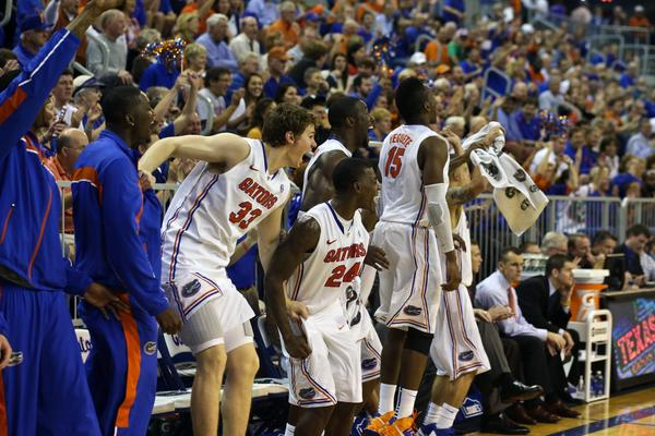 Florida Gators forward/center Erik Murphy (33), guard/forward Casey Prather (24), center Patric Young (4) and forward Will Yeguete (15) react on the bench after Florida scores a basket during the second half of the game against the Georgia Bulldogs at the Stephen C. O'Connell Center. Florida defeated Georgia 77-44.