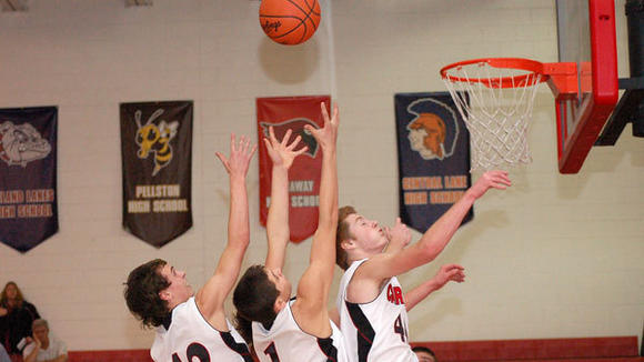 Cardinal rebounders Hunter VanDeKerchove, Brandon Huff and Cameron Nickert (l-r) battle for the ball in J-L's victory against Central Lake Thursday.