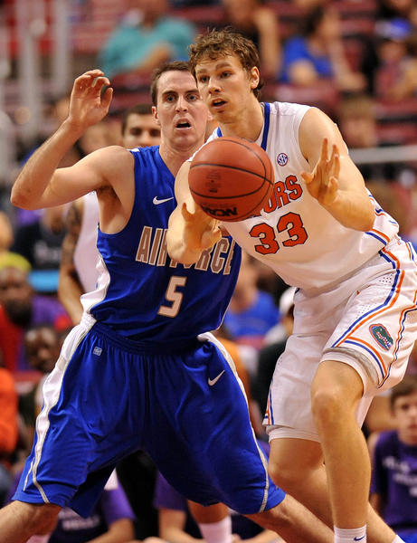 Florida Gators forward/center Erik Murphy (33) is defended by Air Force Falcons forward Mike Fitzgerald (5) during the first half at the Orange Bowl Classic basketball game at the BB&T Center.