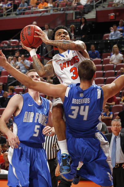 Mike Rosario #3 of the Florida Gators goes to the basket against Taylor Broekhuis #34 of the Air Force Falcons at the MetroPCS Orange Bowl Basketball Classic on December 29, 2012 at the BB&T Center in Sunrise, Florida.