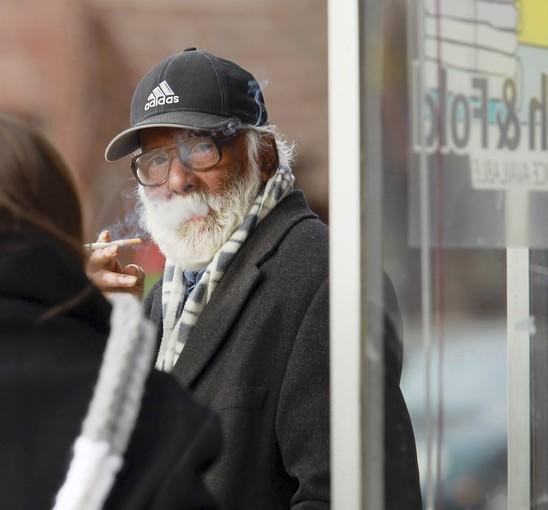 Fareedun Ansari outside his dry cleaning store Thursday. Ansari is the father-in-law of Urooj Khan, who died in July of apparent cyanide poisoning after winning $1 million in the lotto.