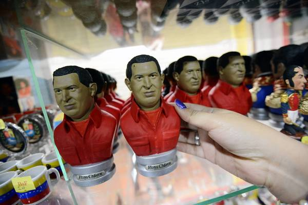 Statuettes depicting Venezuelan President Hugo Chavez are seen on display at a shop in Caracas on January 7, 2012.
