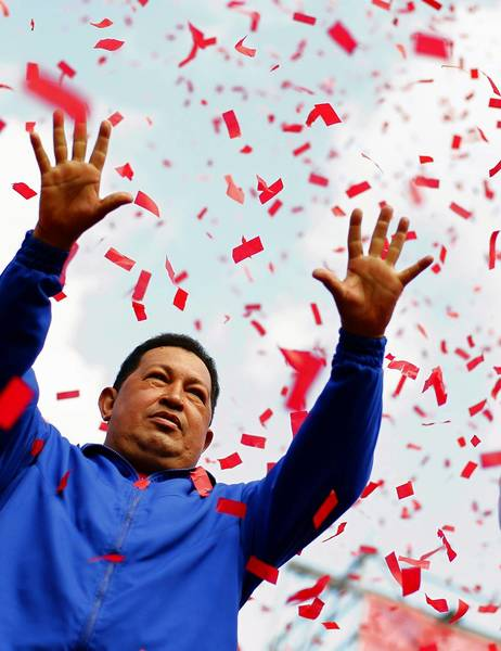 Venezuela's President and presidential candidate Hugo Chavez waves to supporters during a campaign rally on October 3, 2012.