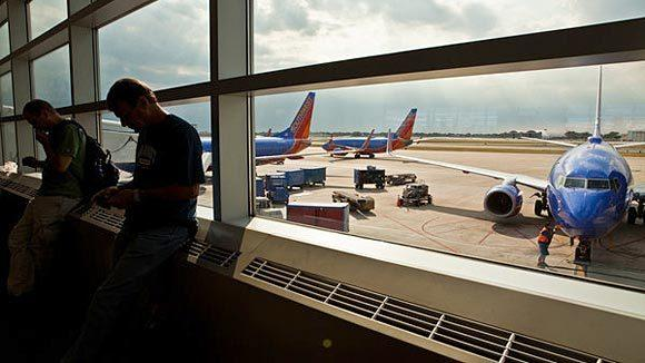 Passengers wait to board Southwest Airlines planes at Midway Airport.