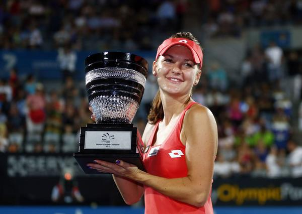 Agnieszka Radwanska of Poland poses with the trophy after defeating Dominika Cibulkova of Slovakia during their women's final match at the Sydney International tennis tournament January 11, 2013.