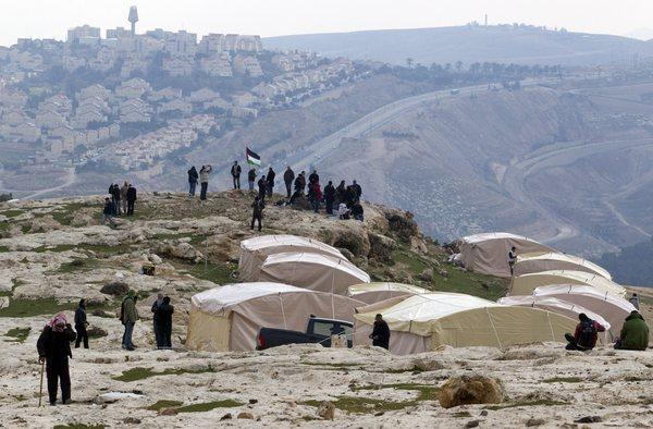 Palestinians set up a tent village that they called Bab al-Shams, or Gate to the Sun, on Friday east of Jerusalem in an attempt to prevent Israeli development of the area.