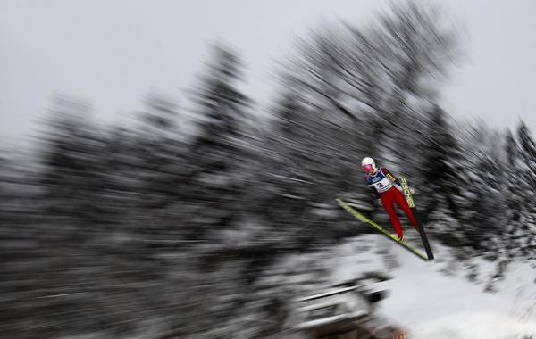 Poland's Jan Ziobro soars through the air during a training session of the FIS World Cup Ski Jumping competition in Zakopane January 11, 2013.