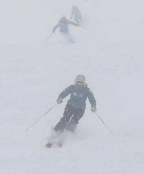 Austria's Andrea Fischbacher (front) and Stefanie Koehle ski in deep snow after the second training for the Alpine Skiing World Cup downhill ski race was cancelled due to heavy snowfall in St. Anton January 11, 2013.