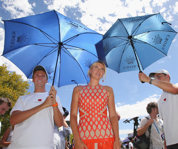 Maria Sharapova of Russia is shaded from the sun by umbrellas held by minders during the launch of Maria Sharapova's new brand 'Sugarpova' at Crown Entertainment Complex on January 11, 2013 in Melbourne, Australia.