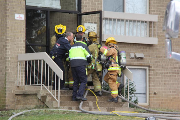 Crews work to rescue the 70-year-old woman, who was found lying on the apartment floor in cardiac arrest.