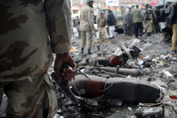 A paramilitary soldier stands guard at the scene of a bomb explosion in Quetta, Pakistan. A bomb blast in a crowded marketplace killed 11 people and injured more than 40 in Pakistan's eastern provincial capital.