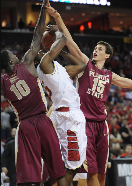 Maryland's James Padgett is blocked from the basket by Florida State's Okaro White (10) and Boris Bojanovsky (15) during second-half action at Comcast Center at College Park, Maryland, on Wednesday, January 9, 2012.