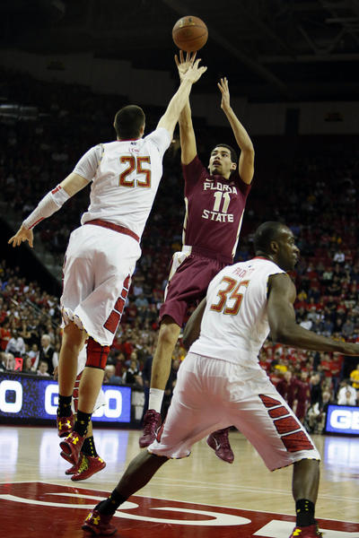 Florida State Seminoles guard Kiel Turpin (11) shoots over Maryland Terrapins center Alex Len (25) at the Comcast Center.