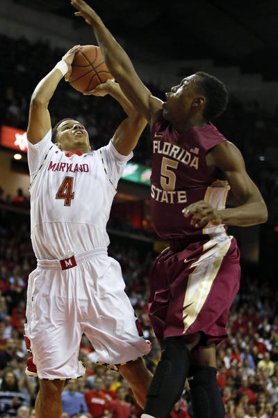Florida State Seminoles guard Montay Brandon (5) defends against Maryland Terrapins guard Seth Allen (4) at the Comcast Center.