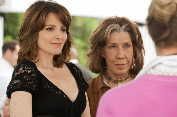 Tina Fey, left, has an intelligence you can sense, Lily Tomlin says.
