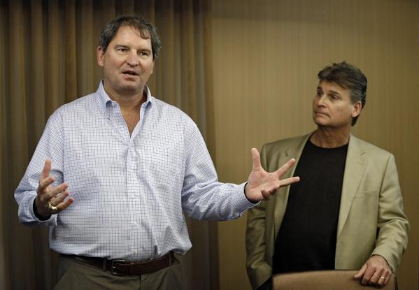 Former Cleveland Browns quarterback Bernie Kosar, left, speaks at a news conference with Dr. Rick Sponaugle, right.