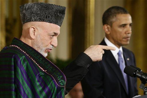 Afghan President Hamid Karzai takes questions from reporters during his joint news conference with President Barack Obama in the East Room at the White House in Washington on Friday.