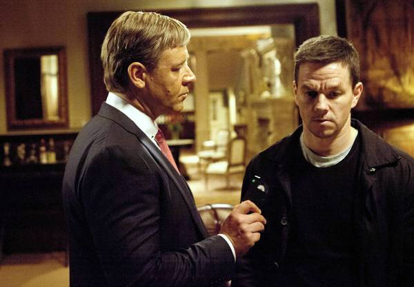 "Russell Crow and Mark Wahlberg star in the movie ""Broken City."""