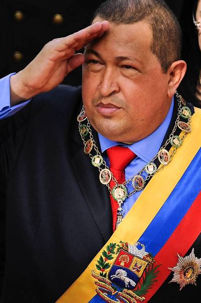 Venezuelan President Hugo Chavez salutes military-style before the Parliament in Caracas on January 13, 2012 during his annual report about the actions and accomplishments of his government.