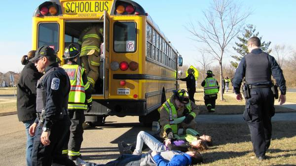 Rotolo Middle School students participate in a training drill with first responders, simulating a bus crash.