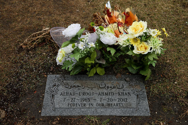 The grave site of Urooj Khan, who may have died of cyanide poisoning after winning a $1 million Lotto prize this past summer, is adorned with flowers At Rosehill Cemetery on Chicago's North Side.