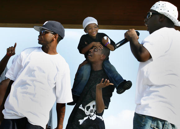 Virginia hip-hop is the subject of a new collection at the William and Mary library. In this photo, members of Ace Boone Clik from Hampton, along with 4-year-old Zavier Wright, perform onstage at King-Lincoln Park in Newport News.