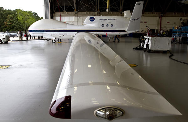Inside the hanger, very long wings. NASA's Global Hawk Mission to Hurricane Leslie.  The unmanned Global Hawk took off today just after 2:30pm for the 24 hr mission to fly over the hurricane at 60,000 feet to take readings and collect data on the storm.