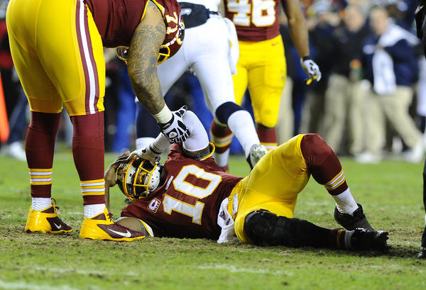 Redskins quarterback Robert Griffin III reacts after tearing his ACL and MCL during a wild-card loss against the Seattle Seahawks.