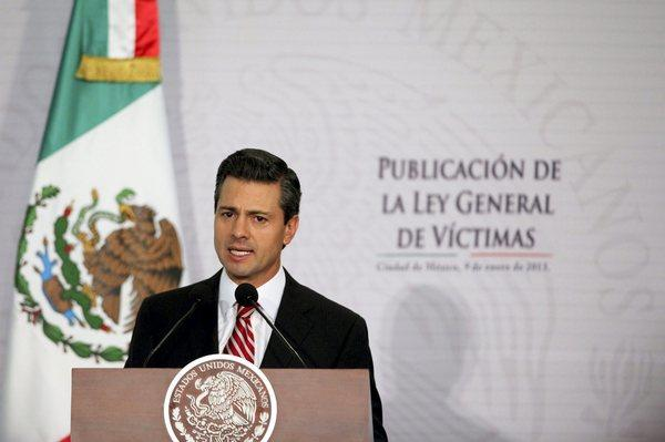 Mexico President Enrique Pena Nieto speaks during the presentation of the Law of Victims initiative in Mexico City on Wednesday, Jan. 9, 2013.