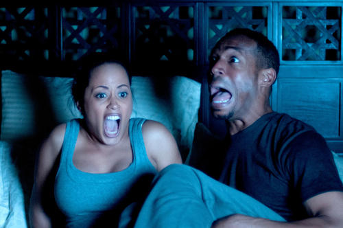 """Essence Atkins and Marlon Wayans star in """"A Haunted House,"""" a parody of found-footage horror movies in the vein of the """"Scream"""" and """"Paranormal Activity"""" movies."""