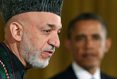 WASHINGTON, DC - JANUARY 11: U.S. President Barack Obama (R) and Afghan President Hamid Karzai speak to the media during a joint news conference in the East Room of the White House January 11, 2013 in Washington, DC. Karzai is in Washington for face-to-face meetings with Obama and senior members of his administration about the future of American commitment to Afghanistan and when troops may leave the country after more than 10 years of war. (Photo by Mark Wilson/Getty Images) ** TCN OUT **